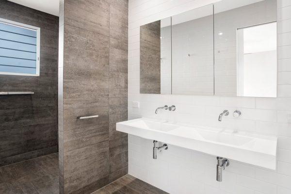 Bathroom with large format porcelain & subway tiles