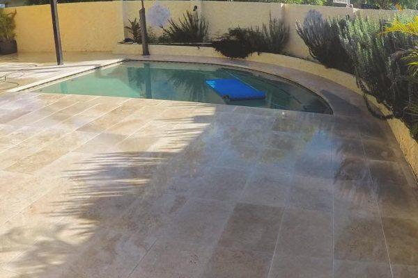 pool are renovation using travertine floor tiles