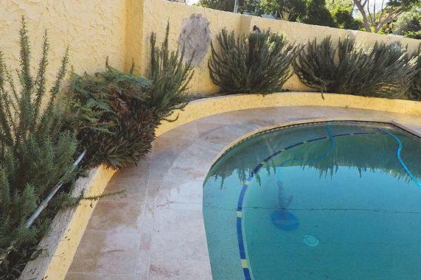 pool area renovation using travertine floor tiles 2