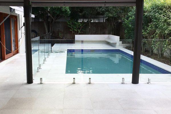 pool area renovation with white granite pavers